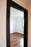 Opened door in empty room Royalty Free Stock Images