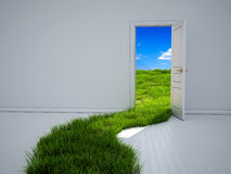 Opened door and grass path. Empty room with opened door and green grass path to the field Royalty Free Stock Image