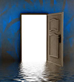 Opened door i water with blue painted wall Stock Photography