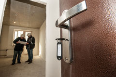 Opened door with the keys in the castle stock photography