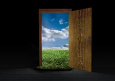 Opened door showing landscape of countryside Stock Photos