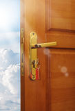 Opened door with sky Royalty Free Stock Image