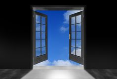 Opened door to blue sky. Royalty Free Stock Image