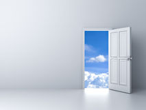 Opened door to blue sky with empty white wall background Royalty Free Stock Images