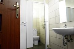 Opened door with toilet Royalty Free Stock Photography
