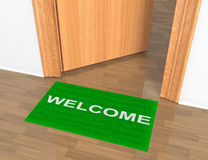 Opened door with welcome rug. On the floor Royalty Free Stock Photos