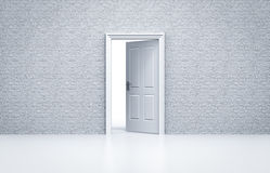 Opened door with white brick wall. Concept Stock Photos