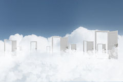 Opened doors to somewhere. Many home white door open in cloudy sky Stock Photo