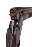 Opened double-barrelled hunting gun with two blue cartridges right rear closeup view isolated on white Stock Photo