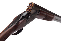 Opened double-barrelled hunting gun with two blue cartridges right rear view isolated on white Stock Photography