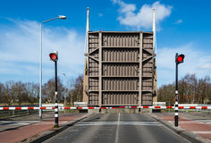 Opened drawbridge across a canal Royalty Free Stock Images