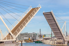 Opened drawbridge allow shipping through at the harbor. Stock Images
