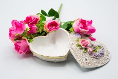 Opened empty heart shape box with decoration bouquet of roses on white background stock photos