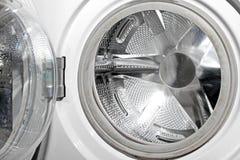 Opened empty washing machine Stock Photos
