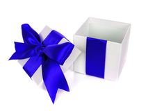 Opened, empty, white Christmas gift box with blue bow Stock Photos