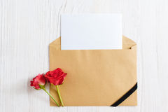 Opened envelope with blank paper and black ribbon Stock Images
