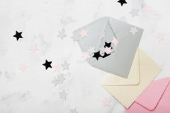 Opened envelope with colorful stars decoration top view. Mail and correspondence concept. Flat lay. Stock Images