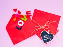 Opened envelope and many felt hearts. colorful of hearts with LOVE text on pink background. stock photo