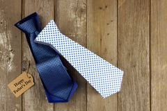 Opened Fathers Day tie shaped gift box agianst wood Stock Image