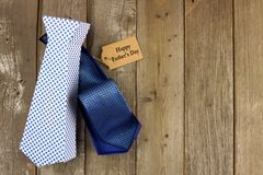 Opened Fathers Day tie shaped gift box on wood background Royalty Free Stock Image