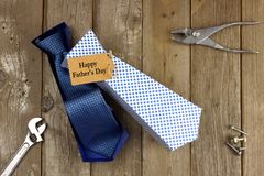 Opened Fathers Day tie shaped gift box on wood background Royalty Free Stock Photography