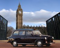 Opened gate of Big Ben & Parliament House. Well come to London - the gate of Big Ben and Parliament House is opened. The taxi car (cab) is in front of it. Sky Royalty Free Stock Image