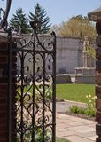 An opened gate leading into a garden stock images