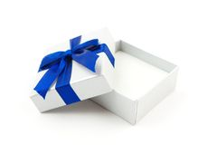 Opened gift with blue bow Stock Images