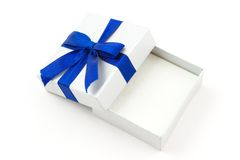 Opened gift with blue bow Royalty Free Stock Image