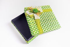 Opened Gift Box. Green pattern texture gift box over white background Stock Images
