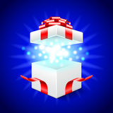 Opened gift box on blue vector background Stock Photos