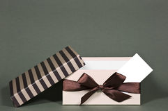 Opened gift box with business card Royalty Free Stock Photography