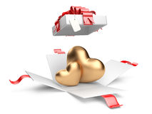 Opened gift box with golden hearts Stock Photos