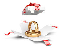 Opened gift box with golden rings Royalty Free Stock Photos