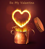 Opened gift-box with hearts. Opened gift-box with hearts blow-up on dark with flame burning inside Stock Images