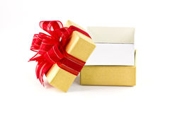 Opened gift box and red ribbon Royalty Free Stock Photography