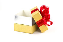 Opened gift box and red ribbon Royalty Free Stock Photos