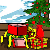 Opened Gift box under a little Christmas tree Stock Image
