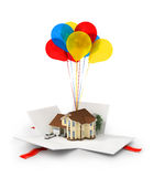 Opened gift with house on the white background. Royalty Free Stock Photo