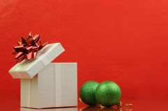 Opened gift in red background Royalty Free Stock Photo