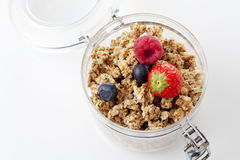 Opened glass with brittle muesli and forest fruits stock photos