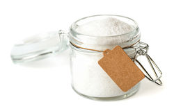 Opened glass jar with paper tag Stock Photography