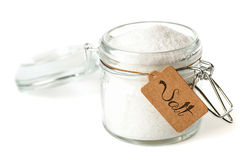 Opened glass jar with salt. Royalty Free Stock Photos