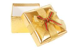 Opened gold gift box Stock Images