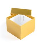 Opened gold gift box with lid. Opened empty golden gift box with lid on white background Stock Image