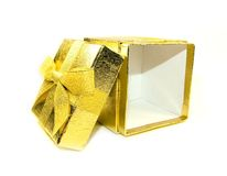 Opened golden gift box Royalty Free Stock Photos