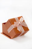 OPENED GOLDEN GIFT BOX WITH BOW Royalty Free Stock Photography
