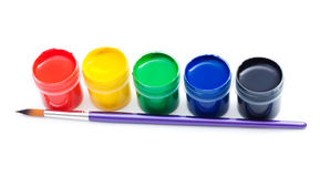 Opened gouache paint buckets with brush Stock Photos