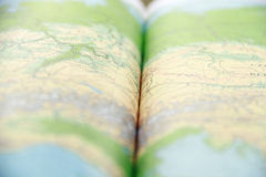 Opened green atlas book Stock Image