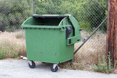 Opened green garbage container Stock Photo